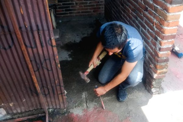 A Pastor With Tools In His Hands
