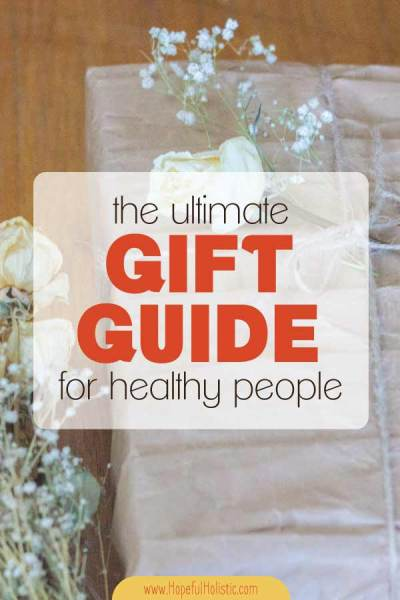 Brown paper wrapped gift with a bouquet of white roses with text overlay- the ultimate gift guide for healthy people