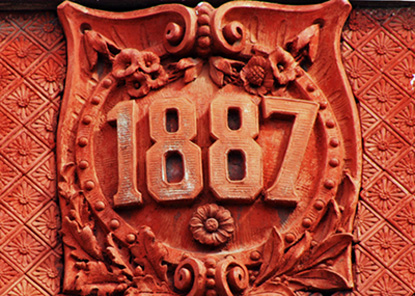 Date marker towards the center of the Sohn-Clyffside building.  But what does the date represent?  Years marked on buildings may not be from the original inception of the company, but an addition to.