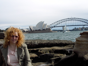 Mélanie Hope in front of the Sydney Opera House and bridge