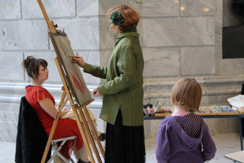 Karen Horne sketching at State capitol, with girl watching