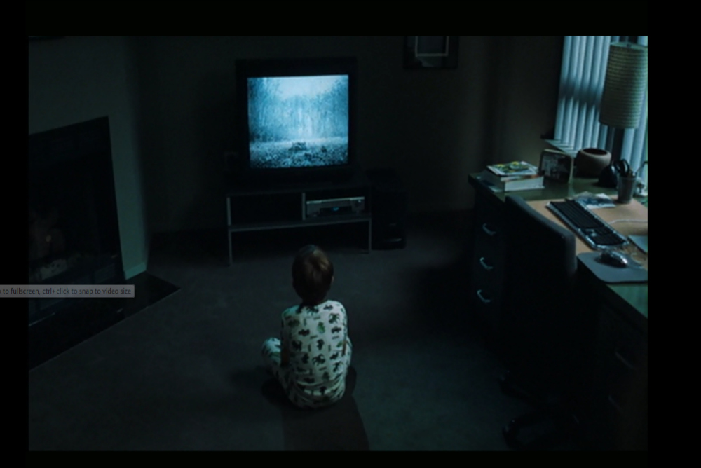 Image 1, Aiden in front of TV