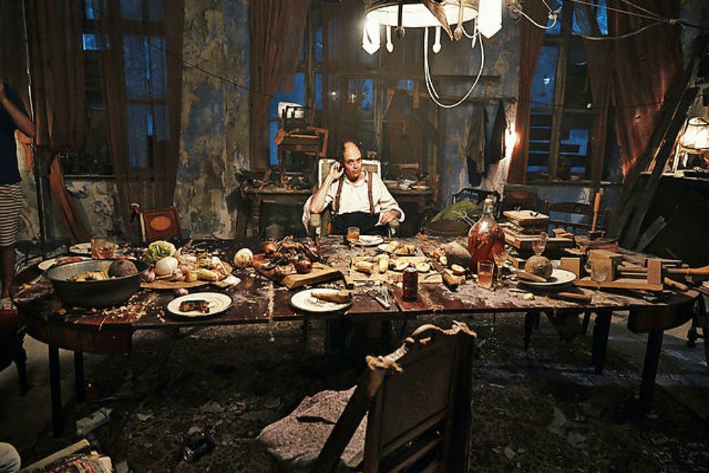 3. Men and Chicken dinner scene