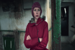 woman in red jacket with arms crossed