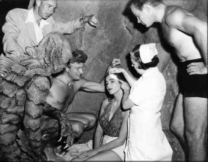 CREATURE FROM THE BLACK LAGOON scream queen Julia Adams getting some much needed medical attention after gill man stunt double Ben Chapman clumsily dropped her!
