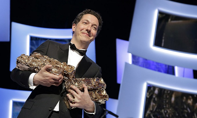 French actor and director Guillaume Gallienne poses with his trophies during the 39th Cesar Awards ceremony in Paris