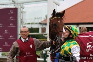 Jean-Pierre Totain with Nahee and jockey Charles Nora in the winners enclosure