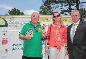 Martial Boisseuil (l) delivers  awards