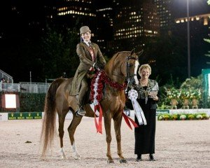 Sally Wheeler-Maier and Captain Courageous PA accept Silver Champion from Cynthia Richardson. Photo by Emma Maxwell