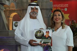HH Sheikh Nahyan Bin Zayed Al Nahyan stands with the Festival's 5th yearbook