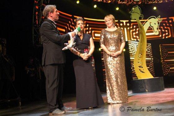 Lara Sawaya and Denise Gault with announcer Derek Thompson