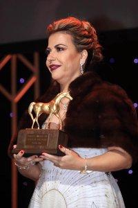 Lara Sawaya holds Award