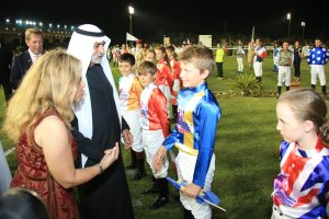 Sheikh Nahayan greeting young riders