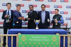 Philip Collington lifts the Royal Cavalry of Oman 'Group 3' ARO Cup for second time