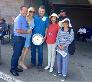 Andre and Nicole Ruggeri are congratulated by Cory Soltau, President, and other members of the Arabian Racing Association of California