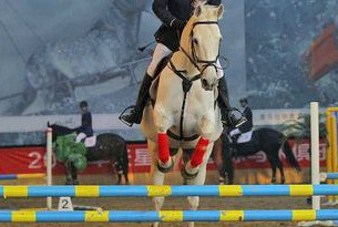 Jumping at the Equuleus International Riding Club near Beijing.