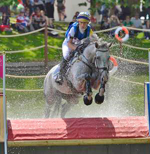 Sweden's Sara Algotsson Ostholt and Wega share the individual lead with Germany's Ingrid Klimke and Butts Abraxxas going into the final jumping phase of the London 2012 Olympic Eventing competition.