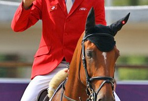 Steve Guerdat of Switzerland riding Nino Des Buissonnets celebrates winning the Gold medal in the Individual Jumping Equestrian on Day 12 of the London 2012 Olympic Games.