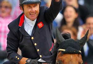 Peter Charles of Great Britain celebrates a clear round on Vindicat W in the jump-off against the Netherlands to help secure Olympic gold at London 2012.