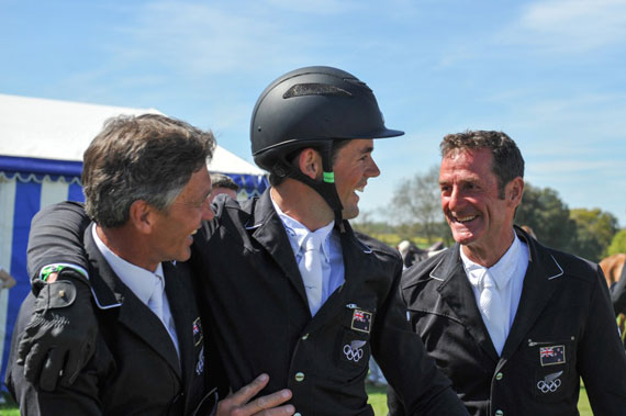 Jonathan Paget is congratulated by fellow Kiwi riders Andrew Nicholson, left, and Mark Todd.
