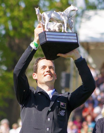 Jonathan Paget hoists the Badminton Trophy after his win on Clifton Promise.