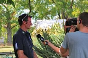 Mark Todd being interviewed by TV presenter Hayley Holt.