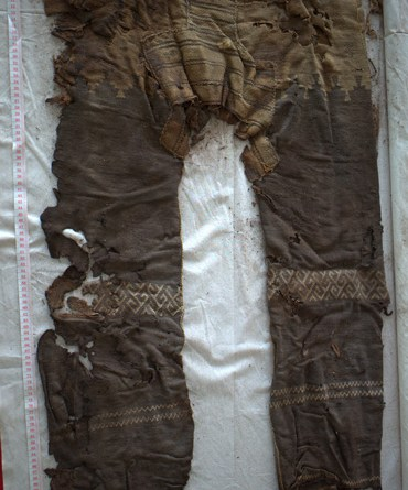 The earliest known trousers, dating back 3300 years, may well have been designed with riding in mind. Photo: Archaeological Institute, M. Wagner