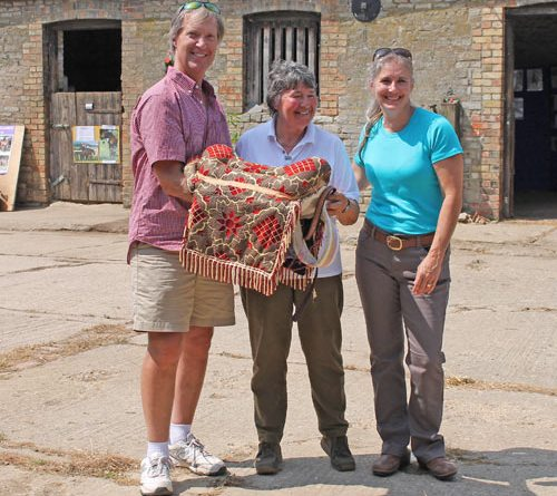 Mark and Kim Thomason present the saddle in memory of Magic Domino to his breeder, Anne Brown.