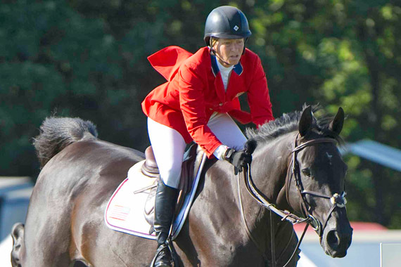 Beezie Madden and Cortes C on their way to winning the Longines King George V Gold Cup at CSIO5* Hickstead.