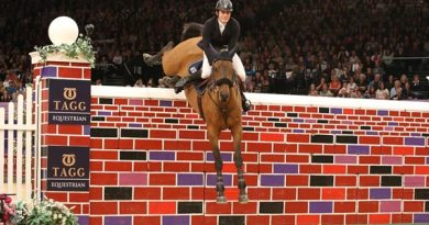 Donald Whitaker and Quick Laura AS Z make it over the 2.19m wall.