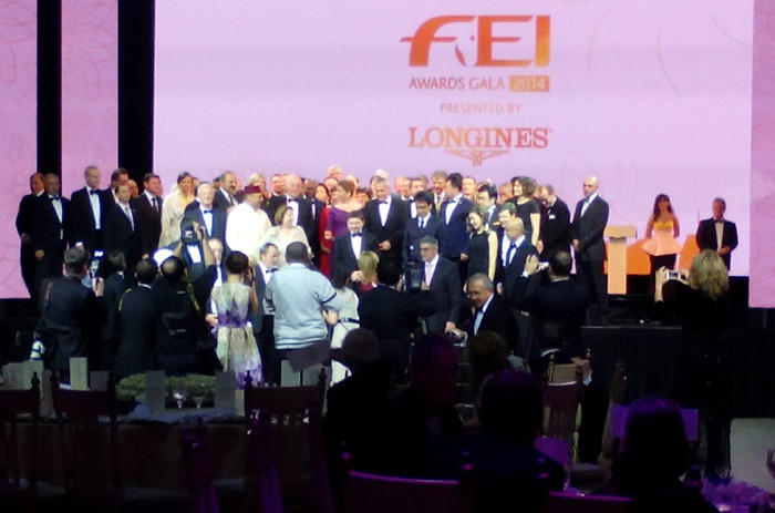 National Federation representatives gather on stage for a family photo.