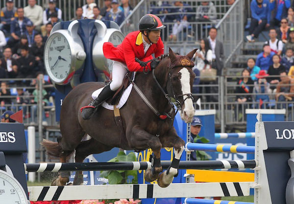 China's Daniel Zhao and Bolero at the World Cup qualifier at Chaoyang Park in Beijing late last year.