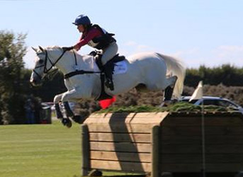 Emily Cammock and Dambala on their way to winning the Land Rover CIC3* at the Horse of the Year show.