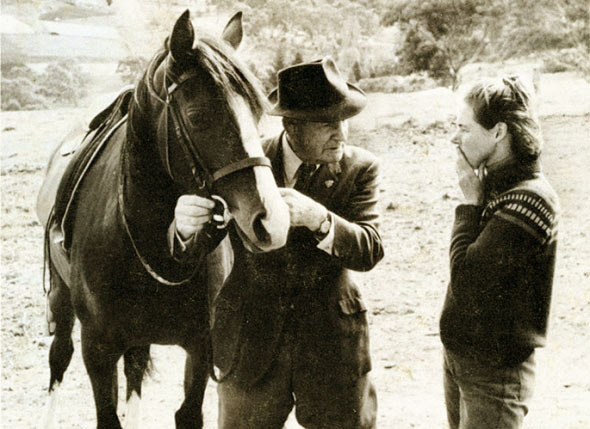 Tom Roberts and Spring Song demonstrate 'feeling for the mouth' to Virginia Batten, Coromandel Valley , South Australia, 1972. Photograph by Webb McKelvey. Published in Tom Roberts, Horse Control – The Young Horse.