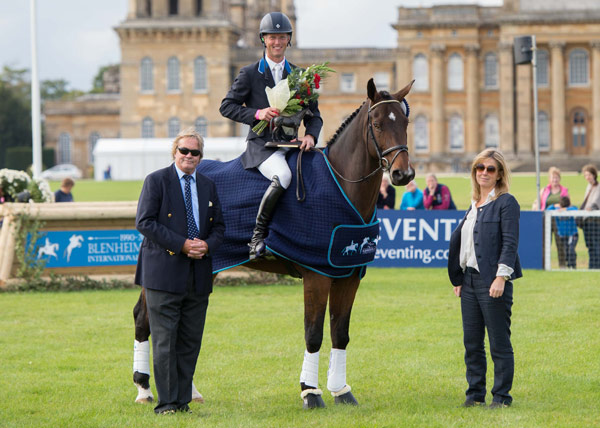 Clark Montgomery receives his prizes from the Duke and Duchess of Marlborough after winning the CCI3* at Blenheim.