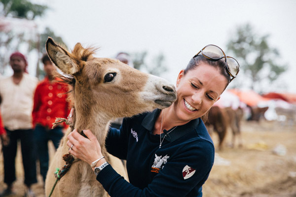 """Charlotte Dujardin meets one of the locals, named """"Brooke"""" on her trip to India."""