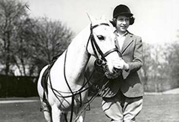 The young Princess Elizabeth with a pony.