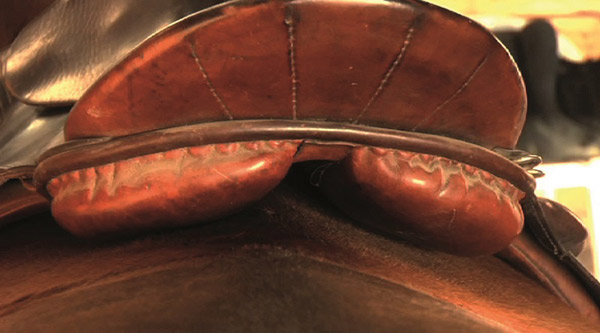 This saddle's gullet channel is too narrow and the saddle has shifted to the left, as can be seen in the picture above at right.