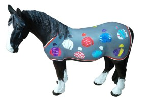 Dash's rug features racing colours by Jamie Osborne, generating almost £6000 in sponsorship.