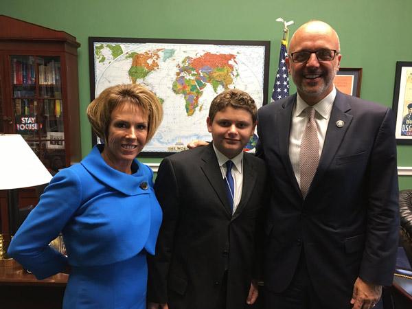 From left, Executive Director of Horses Healing Hearts Liz Olszewski, Dylan Armus and Congressman Ted Deutch in Washington.
