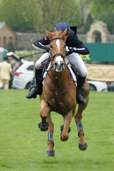 Oliver Townend flies over the course with Armada.