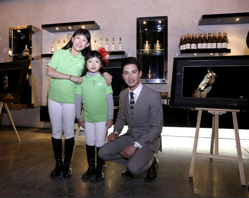 Alex Hua Tian with young fans at The Roosevelt Club in Shanghai for the charity auction.