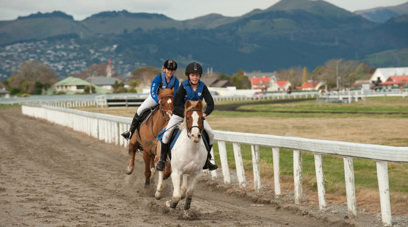 The pony club riders had a ball letting their horses stretch out on the racecourse.