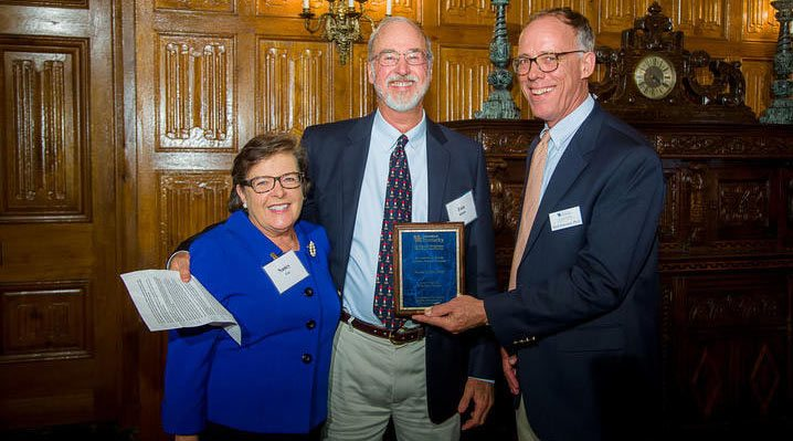 University of Kentucky dean Nancy Cox, left, and UK Ag Equine Programs director Mick Peterson, right, with veterinarian Tom Riddle after he was honored as the 2017 Friend of UK Ag Equine Programs.