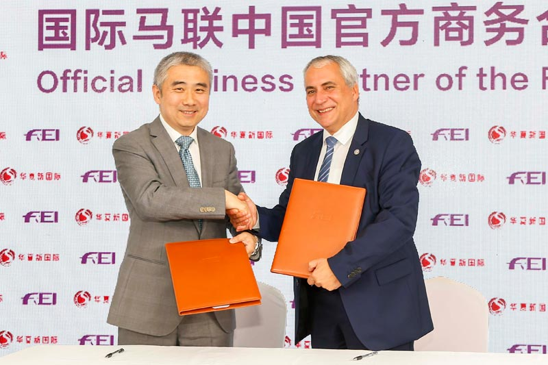 China National Sports International Executive Director Sun Liming with FEI President Ingmar De Vos, following the announcement of a new partnership between the two entities.