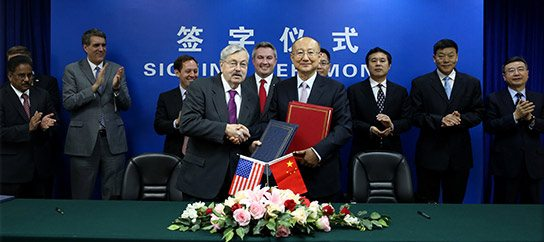 Agriculture Commissioner Ryan Quarles, center, stands behind United States Ambassador Terry Branstad and AQSIQ Minister Zhi Shuping after the signing of an accord which allows the resumption of United States equine exports to the People's Republic of China.