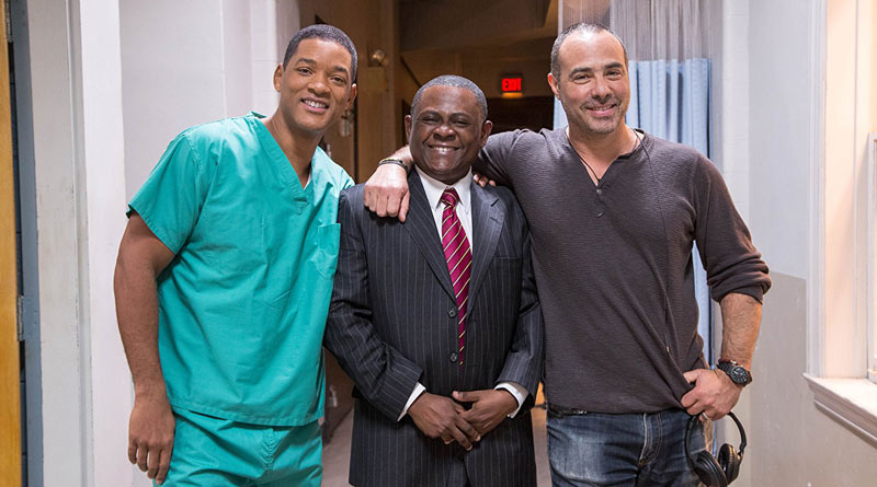 Actor Will Smith at left, with Dr Bennet Omalu, whom he played in the film Concussion, with producer Peter Landesman.