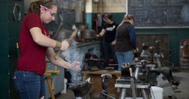 Paige Maxxam working at her anvil in the farrier shop.