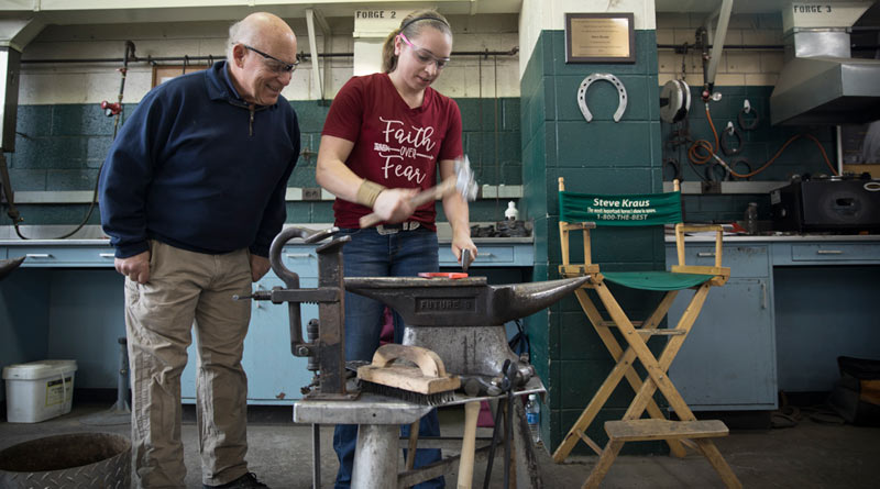 Cornell's Head of Farrier Services Steve Kraus and student Paige Maxxam in the farrier shop.