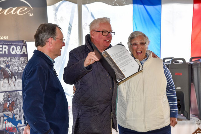 Denis Glaccum presents Tim and Nina Gardner with their letter informing them of their Hall of Fame induction.